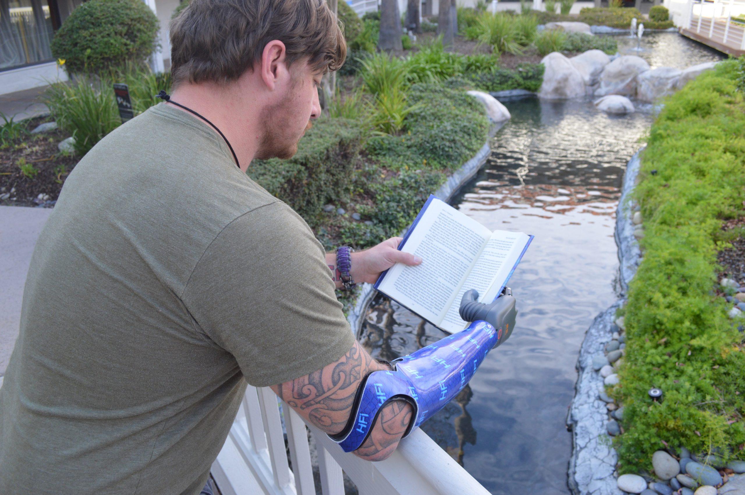 BrainRobotics_prosthetic-hand_readingbook